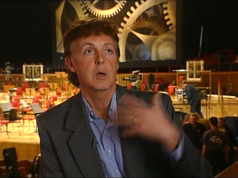 sir paul mccartney performance:; b) 17.10: juliet bremner england: liverpool: philharmonic hall: int side lms sir paul mccartney sitting in concert... - drum percussion instrument stock videos & royalty-free footage