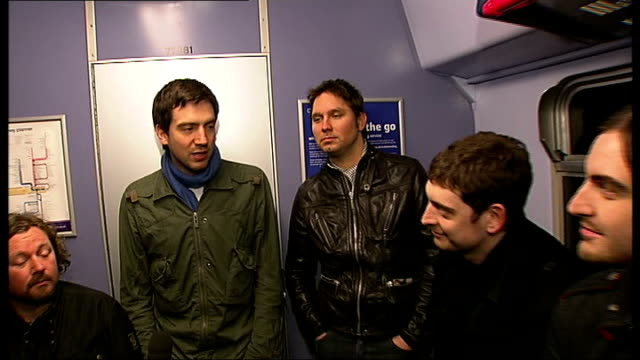 snow patrol interview on train from brighton to london england en route between brighton and london members of indie rock band snow patrol... - album release stock videos and b-roll footage