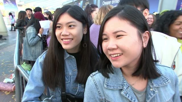 south korean boy band bts sell out o2 gig; uk, london, o2; bts fans queuing at concert. england: london: ext tracking shot past people in queue... - fan enthusiast stock videos & royalty-free footage