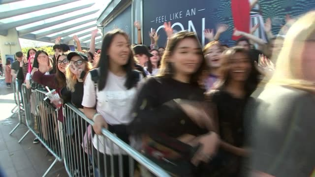 south korean boy band bts sell out o2 gig uk london o2 bts fans queuing at concert england london shot past people in queue waving and cheering sot - waiting in line stock videos & royalty-free footage