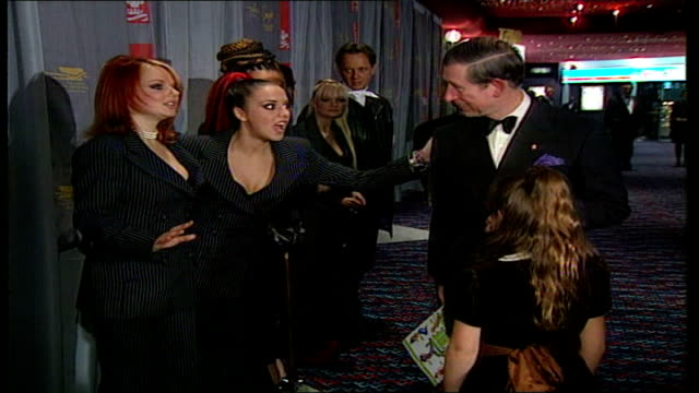vídeos de stock e filmes b-roll de spice girls announce reunion tour lib leicester square prince charles greeting the spice girls at premiere of 'spiceworld' as richard e grant stands... - spice girls