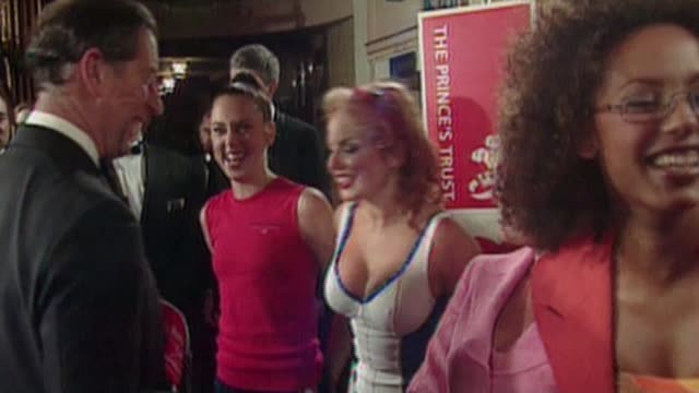 vídeos de stock e filmes b-roll de spice girls 'wannabe' 20th anniversary remake with serious message manchester geri halliwell chatting to then kissing prince charles prince of wales... - spice girls