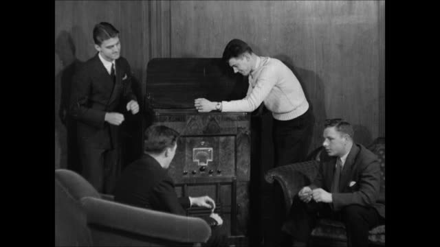 music store int music store young adult males listening to console floor model record player sign 'swing records old amp new' w/ band list int music... - 1937 stock videos and b-roll footage