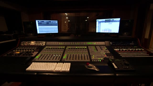 a music studio in east lansing michigan on march 25th 2015 shots wide shot looking through a door into a recording studio with a piano in the center... - lansing stock videos and b-roll footage