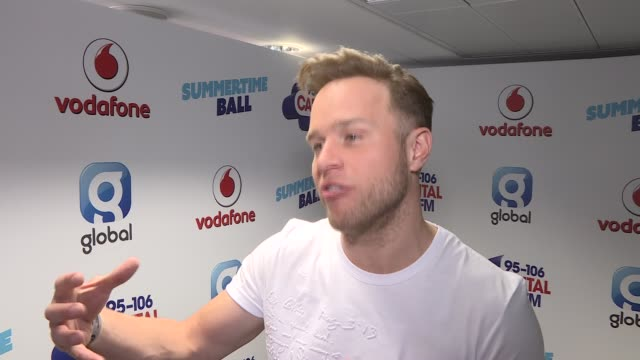 summertime ball: part 1; olly murs photocall and interview sot - being a veteran at the summertime ball, how he feels about seeing the 1d boys going... - hair band stock videos & royalty-free footage