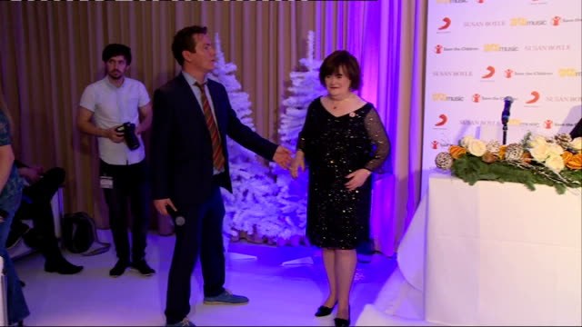 susan boyle christmas single press conference; o'grady press conference sot boyle posing for photocall / st bernarddog / susan boyle interview sot st... - fake snow stock videos & royalty-free footage