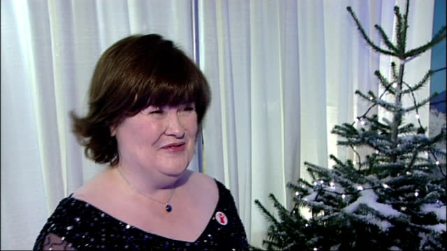 susan boyle to duet with elvis presley on christmas record; england: london: int susan boyle interview sot - talks about recording a song with elvis... - スーザン ボイル点の映像素材/bロール