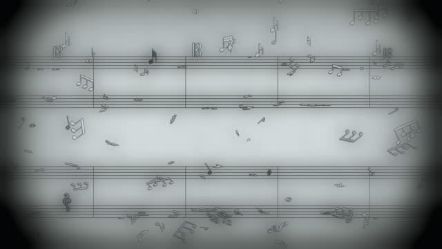 b/w, cgi, music symbols falling against music score - spartito video stock e b–roll