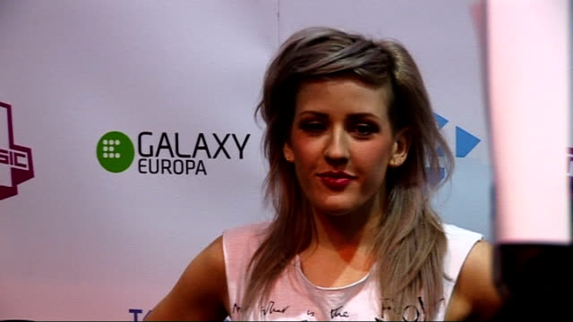 vídeos de stock, filmes e b-roll de t4 stars of 2010 red carpet interviews ellie goulding posing for press goulding interview sot has no idea what to expect from performance tonight /... - ellie goulding