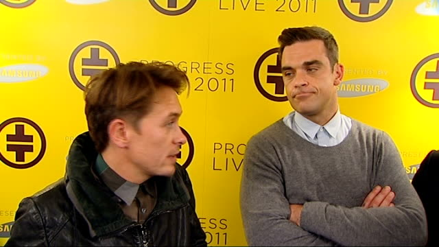 take that announce 2011 tour dates gary barlow robbie williams and mark owen interview sot [owen] i think rob being here first of all for us it's the... - boy band stock videos & royalty-free footage