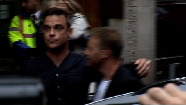 take that gary barlow and robbie williams appear at radio 1 portland place photography*** williams and barlow posing for photocall with arms round... - take that stock videos and b-roll footage