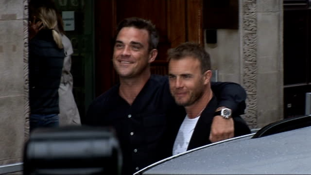 gary barlow and robbie williams appear at radio 1; music: take that: gary barlow and robbie williams appear at radio 1; england: london: ext ** music... - bbc radio stock videos & royalty-free footage