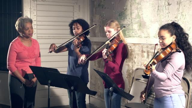 music teacher, teenage students playing violin - violin stock videos & royalty-free footage