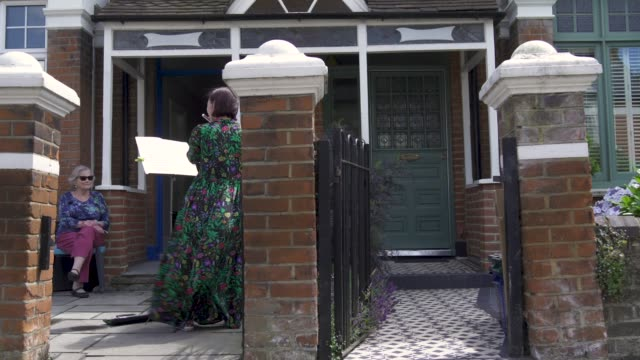 music teacher zoe purdiewood performs a classical music concert for 79 year old barbara layton – retired maths teacher outside her home in east... - retirement stock videos & royalty-free footage
