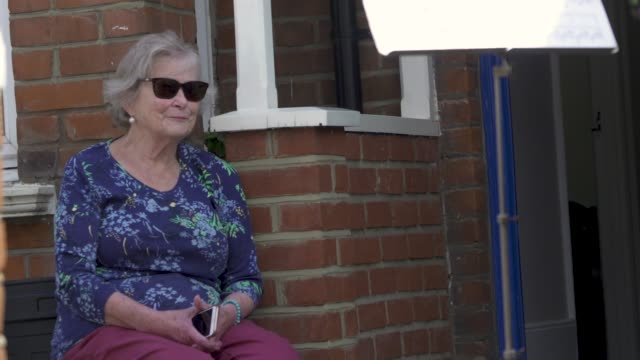 music teacher zoe purdiewood performs a classical music concert for 79 year old barbara layton – retired maths teacher outside her home in east... - fragility stock videos & royalty-free footage