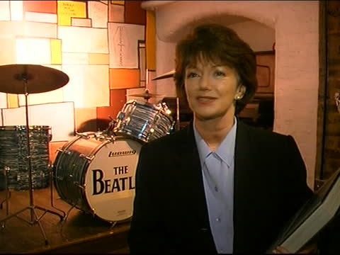 the beatles anthology goes on sale england liverpool int sheila johnston interview sot talks about the beatles anthology - itv lunchtime news stock videos & royalty-free footage