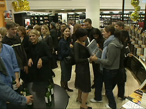 the beatles anthology goes on sale england london piccadilly waterstones hands as remove plastic wrapping from around book lms beatles fans posing... - itv lunchtime news stock videos & royalty-free footage