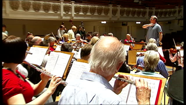 the really terrible orchestra richard nevilletowle interview sot nevilletowle conducting 1812 overture pull out peter stevenson interview sot close... - woodwind instrument stock videos and b-roll footage