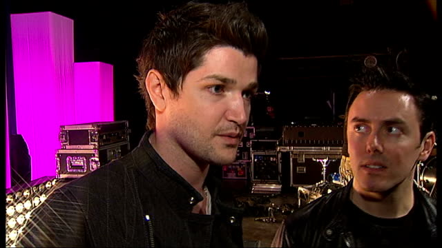 the script interview; the script interview continues sot - on how they met in january 2005 / how they chose the band name / supporting take that on... - ポピュラーミュージックツアー点の映像素材/bロール