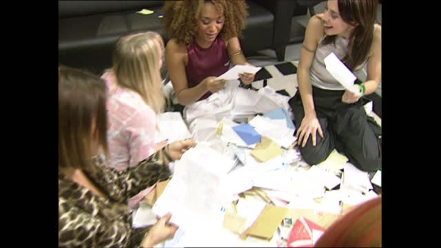 the spice girls interview; england: london: int the spice girls sitting on floor reading fanmail letters and hate mail and chatting sot - mel b , mel... - spice girls stock videos & royalty-free footage
