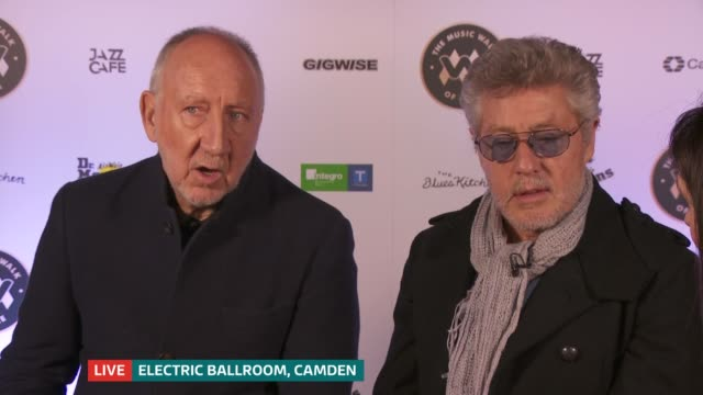 'the who' become first name on camden's music walk of fame; england: london: camden town: ext roger daltrey and pete townshend watching music walk of... - roger daltrey stock-videos und b-roll-filmmaterial