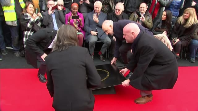 the who become first name on camden's music walk of fame england london camden ext roger daltrey and pete townshend helping to unveil their slab /... - block shape stock videos & royalty-free footage