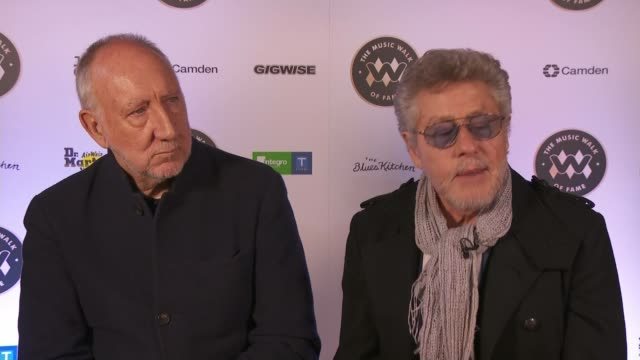the who become first name on camden's music walk of fame; england: london: camden: roger daltrey and pete townshend interview sot ext pete townshend... - pavement点の映像素材/bロール
