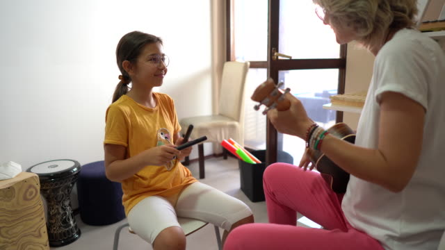 music therapy makes girl happy at rehabilitation center - invisible disability stock videos & royalty-free footage