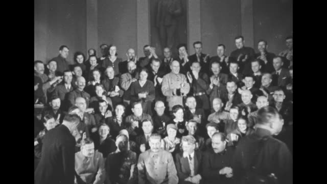 vídeos de stock, filmes e b-roll de [vo music throughout] three shots of members of presidium standing in rows applauding / closer shot of joseph stalin general secretary of communist... - 1930 1939