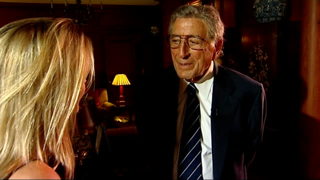 tony bennett interview england london int **music overlaid sot** tony bennett interview with reporter in shot sot i'm very fortunate i count my... - tony bennett singer stock videos and b-roll footage
