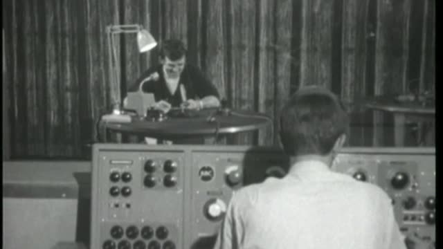 top 40 position to include streaming of music videos online; uk, london, library footage 1966 alan freeman broadcasting radio show 'pick of the... - top of the pops stock videos & royalty-free footage