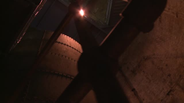 tower bridge 'bascule chambers' to host music concert; england: london: tower bridge: int point of view shots - povs - as down spiral staircase into... - bascule bridge stock videos & royalty-free footage