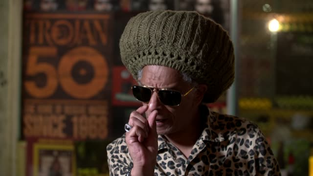 trojan records celebrates 50th anniversary england london brixton don letts interview sot anthony 'chips' richards interview sot - channel 4 news stock videos & royalty-free footage