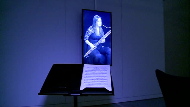 'universe of sound' exhibition at the science museum music stand in front of screen showing woman playing instrument television screen showing woman... - music stand stock videos and b-roll footage