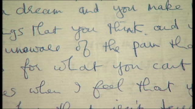 unpublished lyrics by george harrison unveiled at british library england london british library int hand holding piece of paper with previously... - george harrison stock videos & royalty-free footage