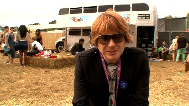 festival 2011; gvs pixie lott gvs of nicky wire playing with his jewellery nick wire interview sot - on how great v is and the mix of acts - on... - manic street preachers stock videos & royalty-free footage