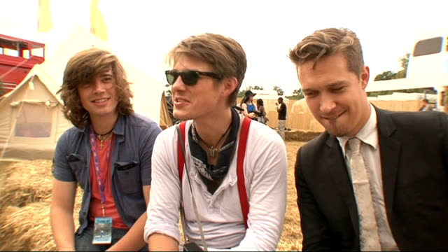 festival 2011; hanson interview sot - on eminem - on v - lots of friends and they had a great set - on the crowd - of course they did mmm bop and the... - popular music tour stock videos & royalty-free footage