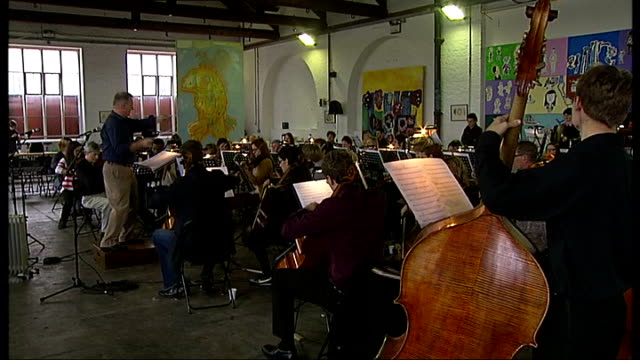 water city festival orchestra formed over one weekend england london int sequence showing musicians of the water city festival orchestra tuning their... - cellist stock videos & royalty-free footage