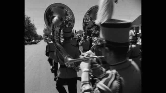 musical band marching on street - trumpet stock videos & royalty-free footage