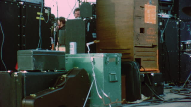 cu zo ms musical equipment and people on stage at woodstock festival / bethel, new york, usa - amplifier stock-videos und b-roll-filmmaterial