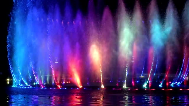 musical fountain with colorful illuminations at night - fountain stock videos & royalty-free footage