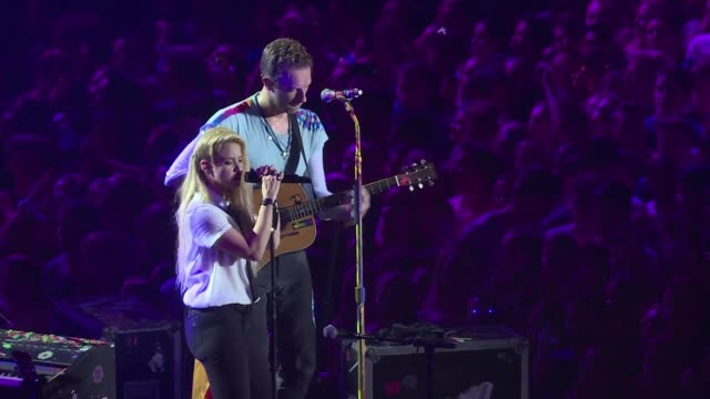 musical superstars shakira and coldplays chris martin perform at a benefit concert held on the sidelines of the g20 summit in hamburg - benefit concert stock videos and b-roll footage