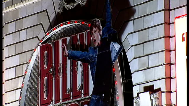 Sir Elton John attends celebration of 7 years of Billy Elliot ENGLAND London General views of theatre with Billy Elliot neon signs