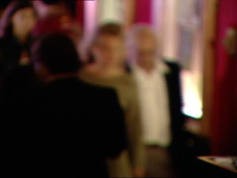 DAY Musician Arthur Garfunkel female walking through busy Ziegfeld movie theatre lobby people press attendants around