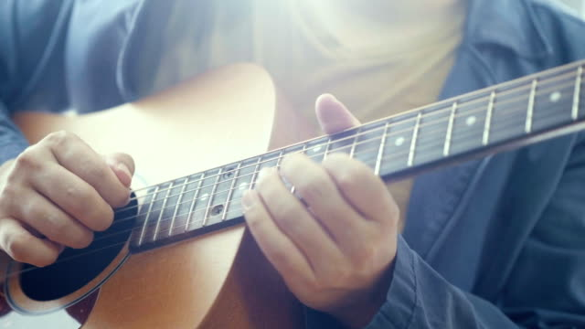 musician : close-up hand playing guitar - guitar stock videos & royalty-free footage