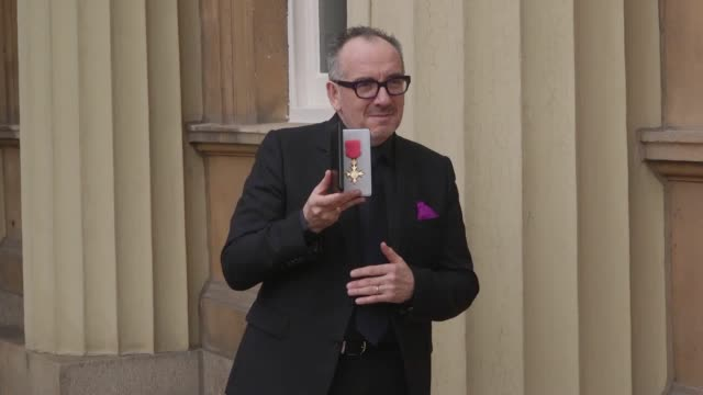 musician declan patrick macmanus, best known by his stage name elvis costello, speaks about receiving his obe from the prince of wales at buckingham... - elvis costello stock-videos und b-roll-filmmaterial