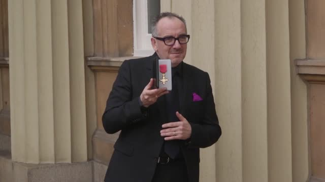 musician declan patrick macmanus, best known by his stage name evis costello, speaks about receiving his obe from the prince of wales at buckingham... - elvis costello stock-videos und b-roll-filmmaterial