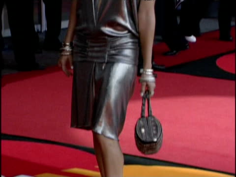 Musician Fergie poses in silver dress at The Brit Awards London 17 February 2004