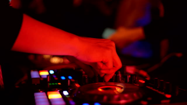 musician hands mixes the track on dj stage in night club at disco party - club dj stock videos & royalty-free footage