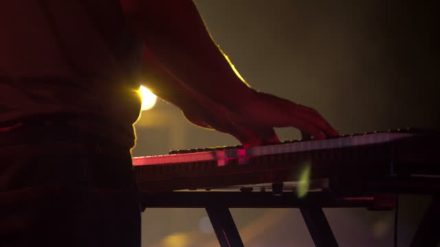 musician hands playing keyboard at concert - piano key stock videos & royalty-free footage